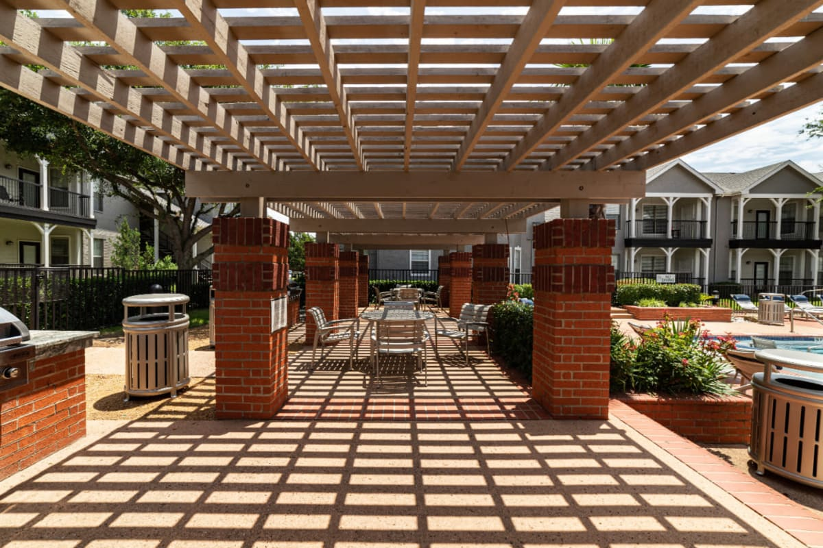 Outdoor covered BBQ and dining area at Marquis at Lantana in Flower Mound, Texas
