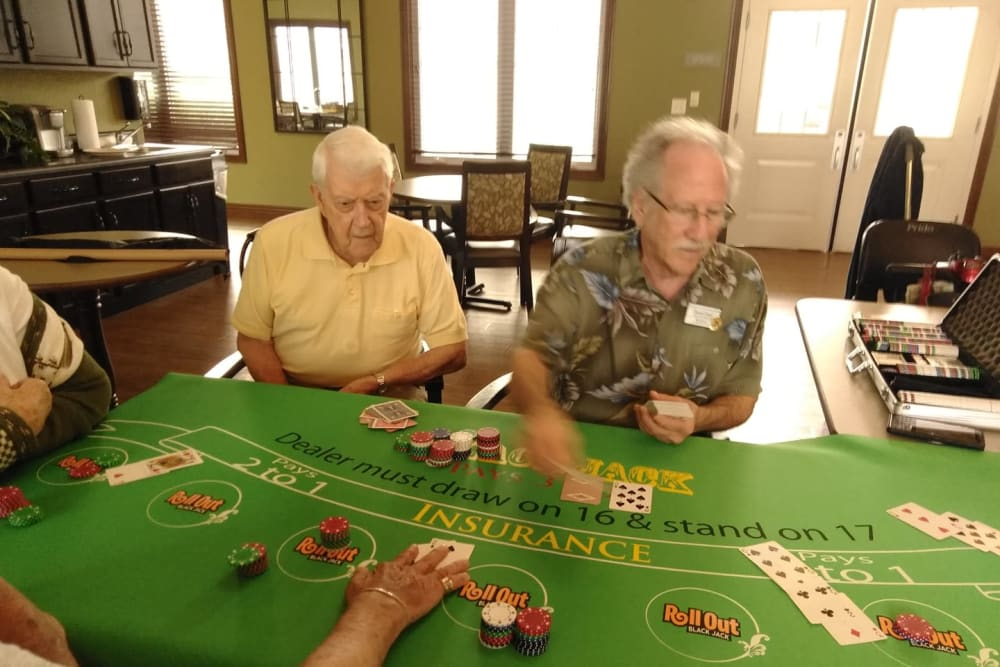 Residents playing poker at Villas of Holly Brook Herrin in Carterville, Illinois