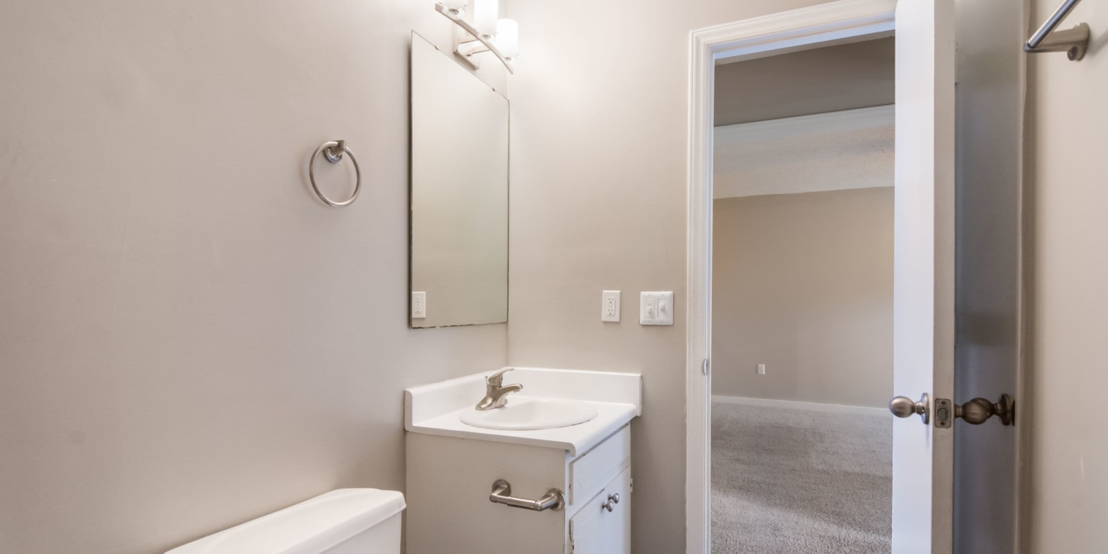 Bathroom with a vanity mirror at 1022 West Apartment Homes in Gaffney, South Carolina