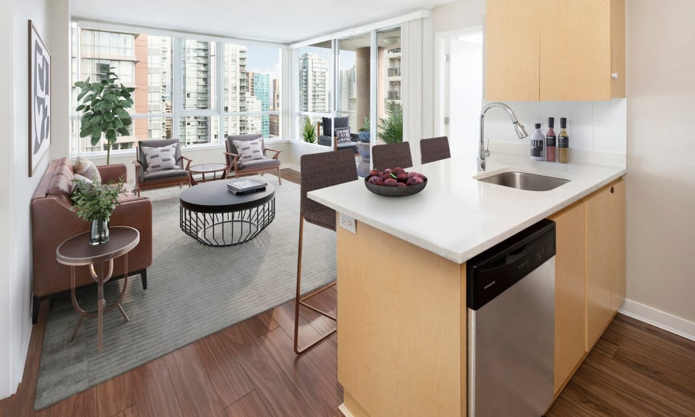 Spacious open floor plan with kitchen island at Metropolitan Towers in Vancouver, British Columbia