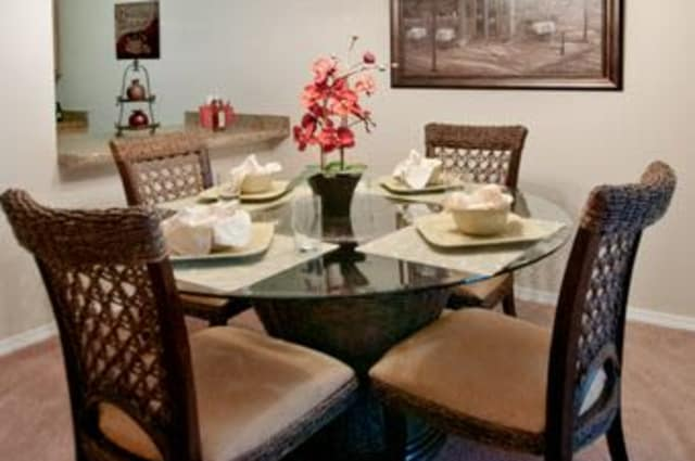 Glass dining table at Summerfield Apartment Homes in Harvey, Louisiana