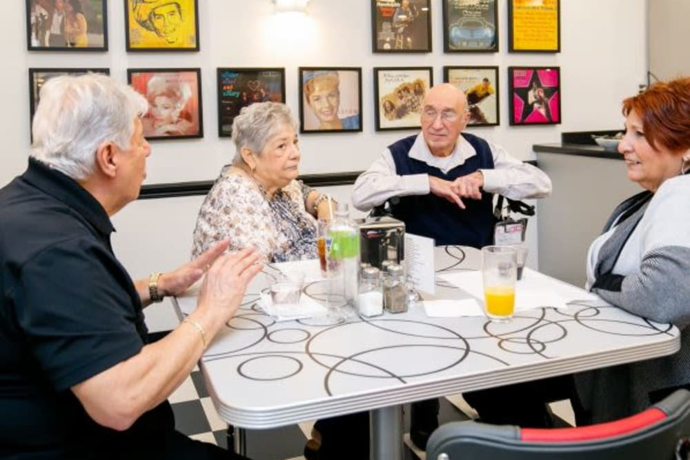 Residents enjoying beverages in the bisro/cafe at Mercer Hill at Doylestown in Doylestown, Pennsylvania
