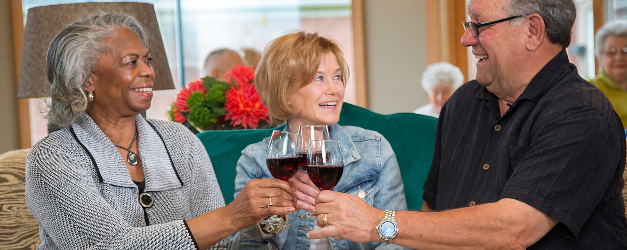 Residents enjoying a glass of wine at one of our communities at All Seasons Senior Living in Farmington Hills, Michigan