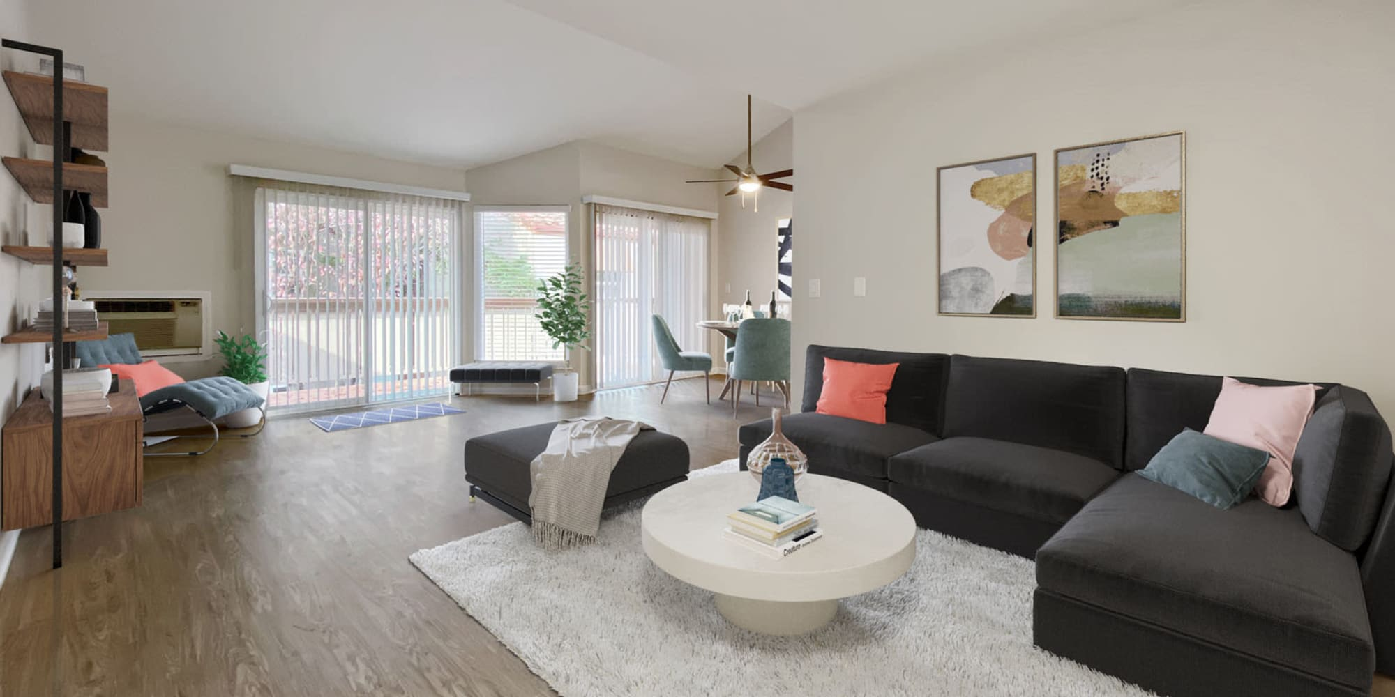 Modern furnishings in the open-concept living area of a model home at Valley Plaza Villages in Pleasanton, California