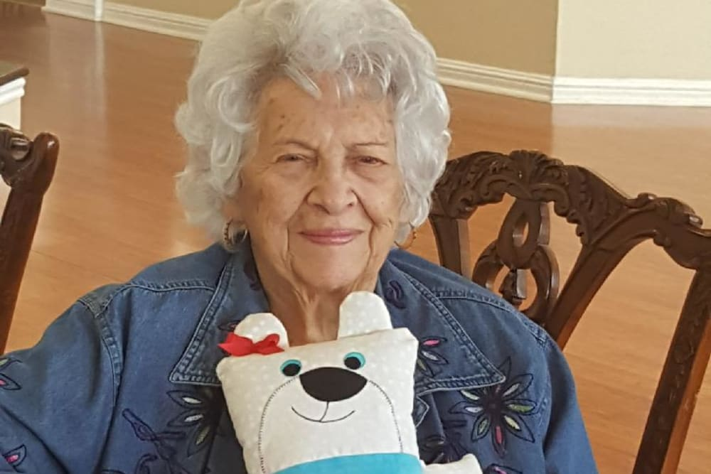 Resident with stuffed animal at Parsons House Frisco in Frisco, Texas