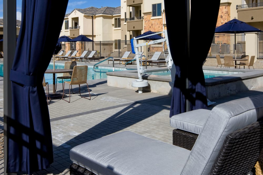 Covered lounge area by the pool at Olympus Alameda in Albuquerque, New Mexico