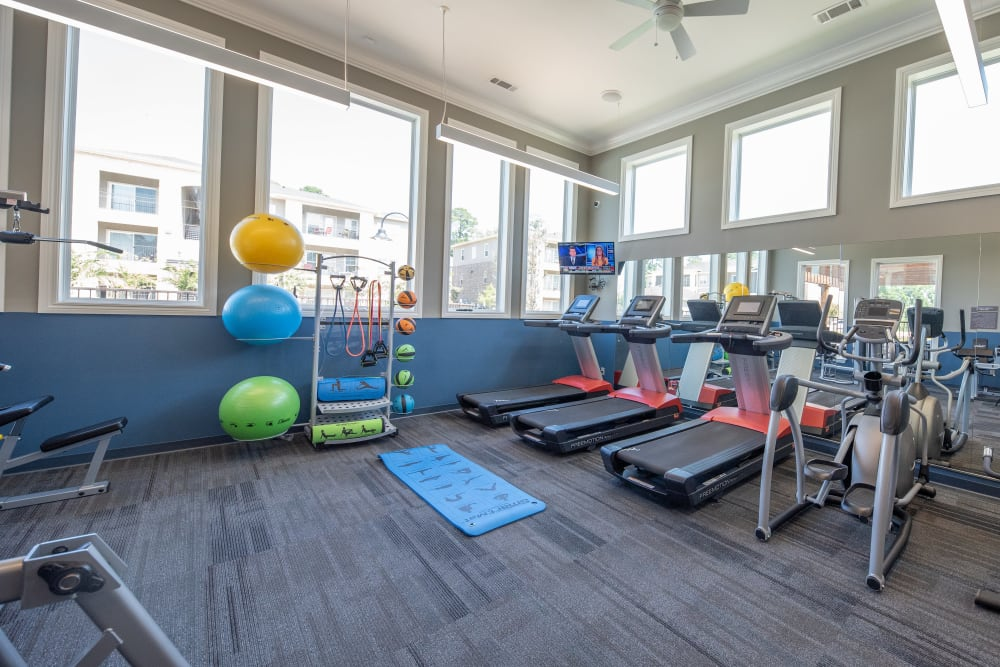 Well equipped fitness center at Hilltops in Conroe, Texas