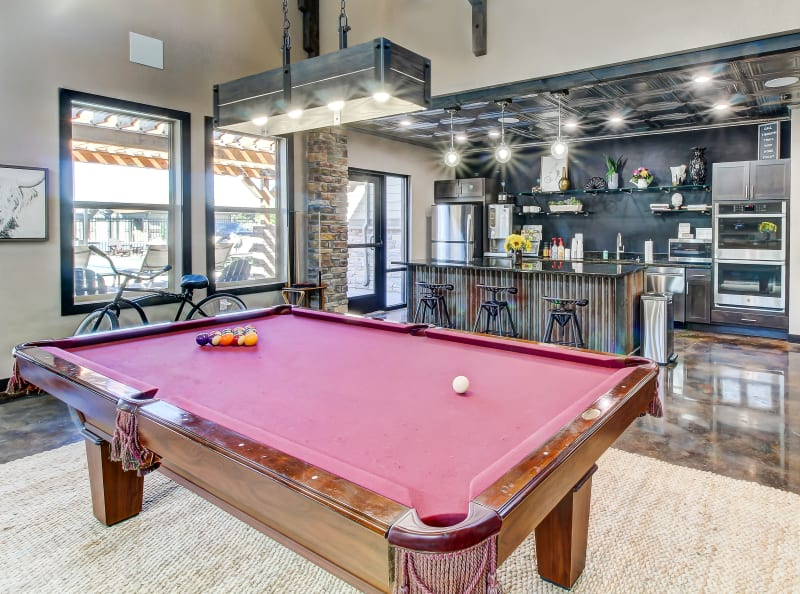 Pool table and clubhouse kitchen Timnath Trail at Riverbend Apartment Homes in Timnath, Colorado