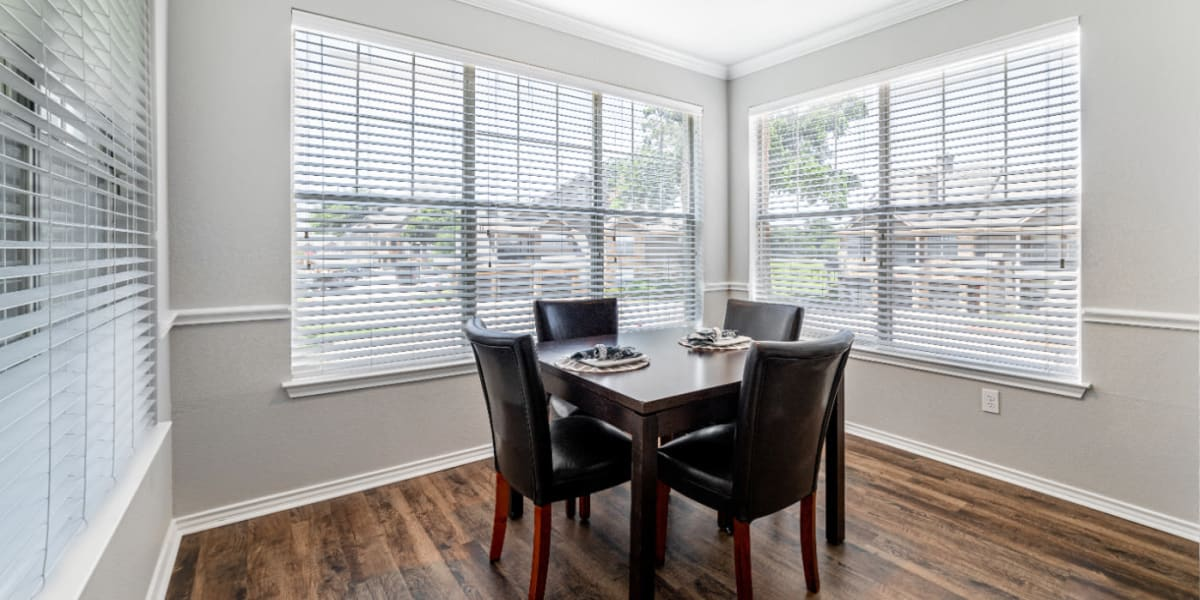 Bright dining room with large windows at Marquis at Bellaire Ranch in Fort Worth, Texas
