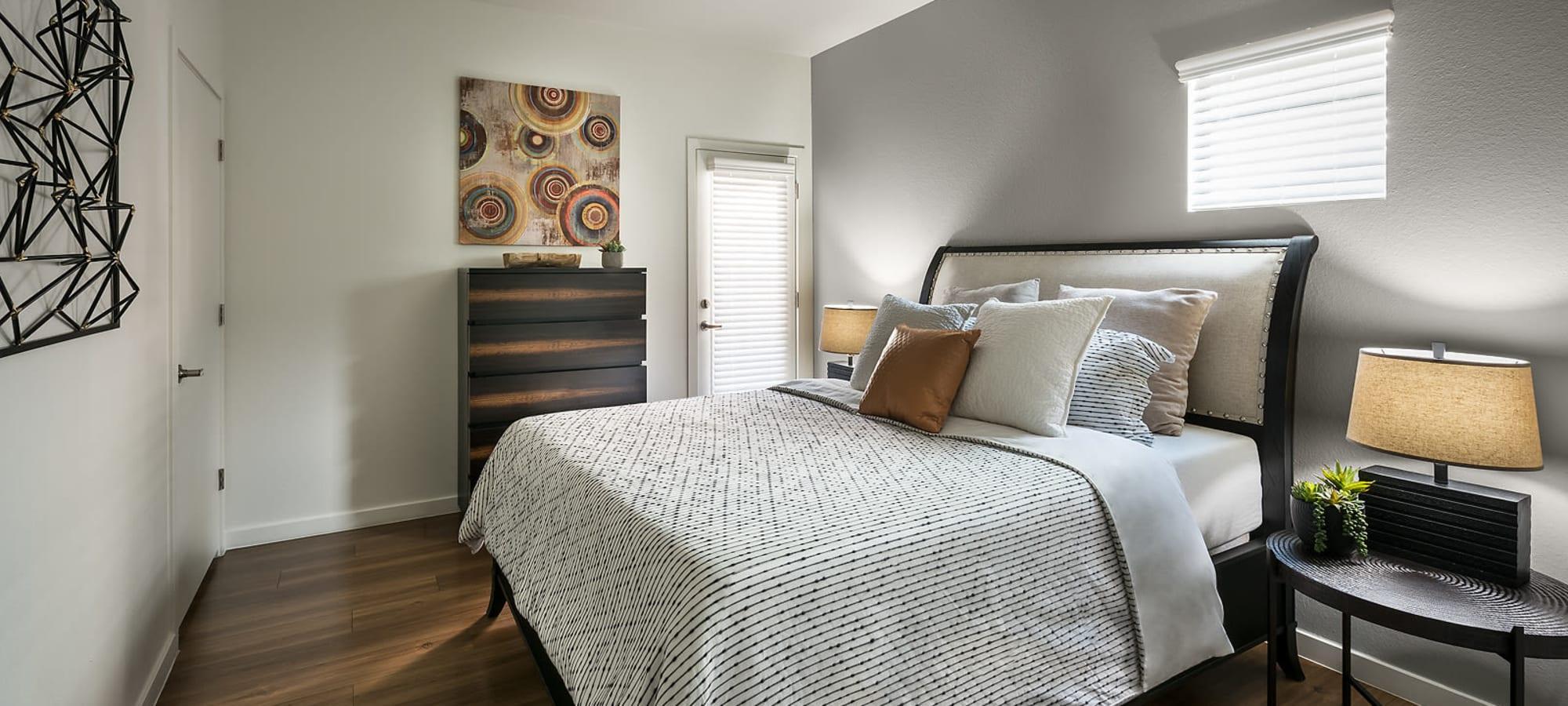 Bedroom with hardwood flooring at The Maxx 159 in Goodyear, Arizona