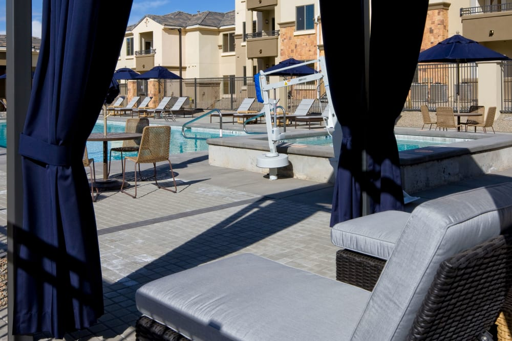 Swimming pool area with comfortable lounge chairs at Olympus Alameda in Albuquerque, New Mexico