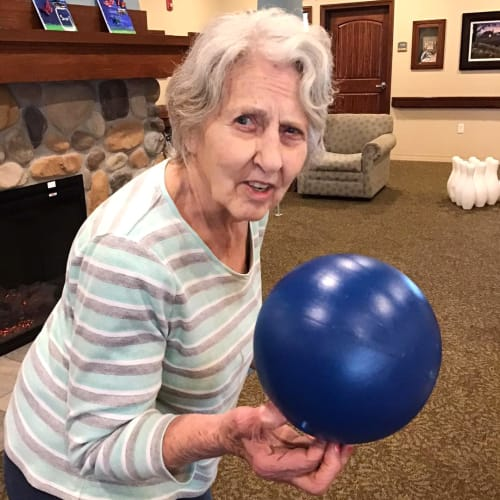 Resident holding a balloon at Oxford Glen Memory Care at Owasso in Owasso, Oklahoma