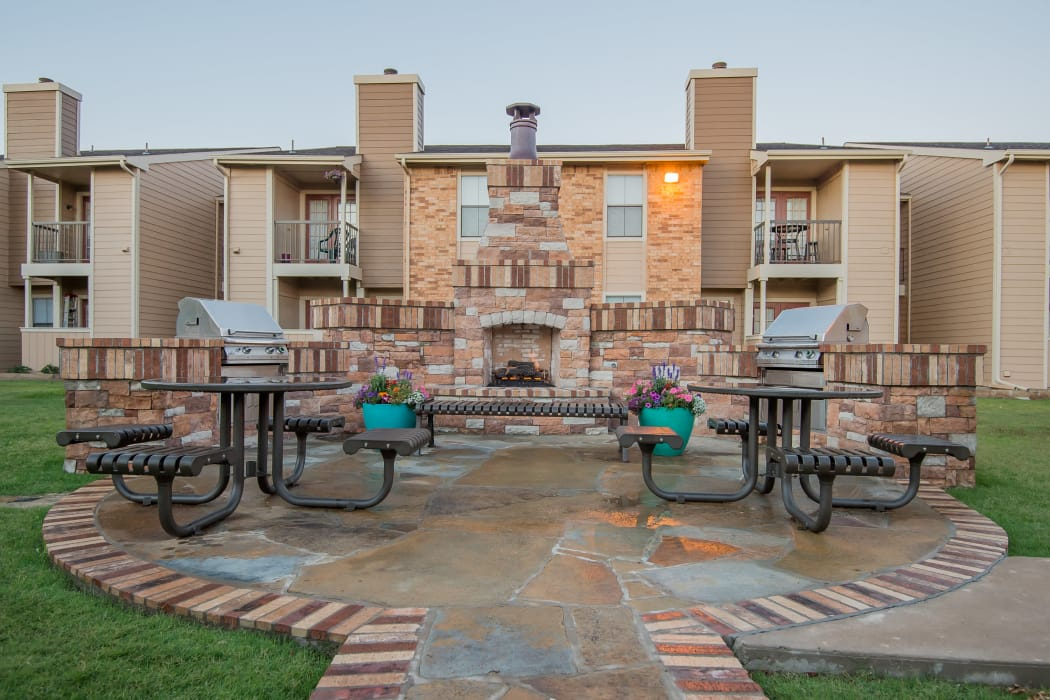 Outdoor patio area with grill access at Cimarron Trails Apartments in Norman, Oklahoma