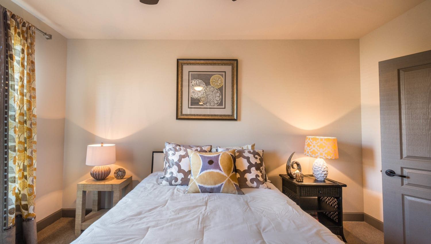 Classic decor in a model home's master bedroom at Union At Carrollton Square in Carrollton, Texas