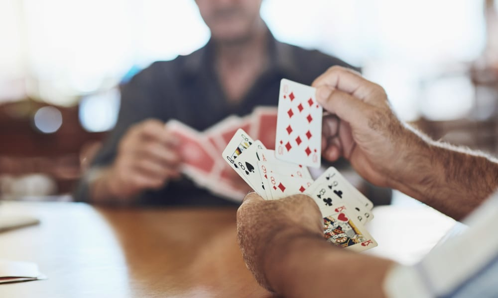 Playing cards at Abrams Hall Senior Apartments in Washington, District of Columbia