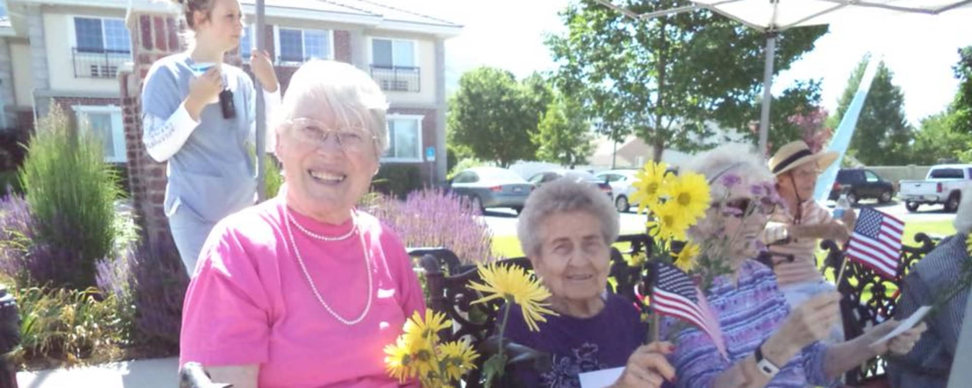 Happy seniors with flowers at The Charleston at Cedar Hills in Cedar Hills, Utah