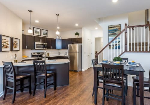 Kitchen with stainless steel appliances at The Links at CenterPointe Townhomes in Canandaigua, New York