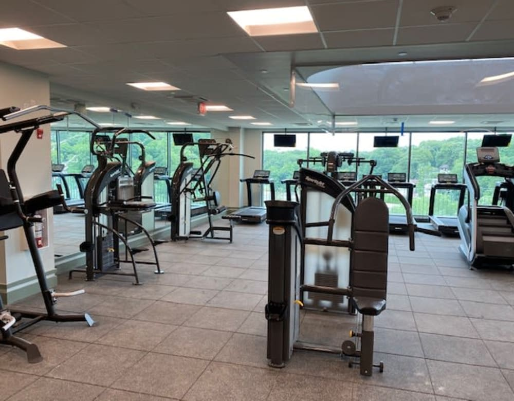 Fitness center with large window at Monarch at Ridge Hill in Yonkers, New York