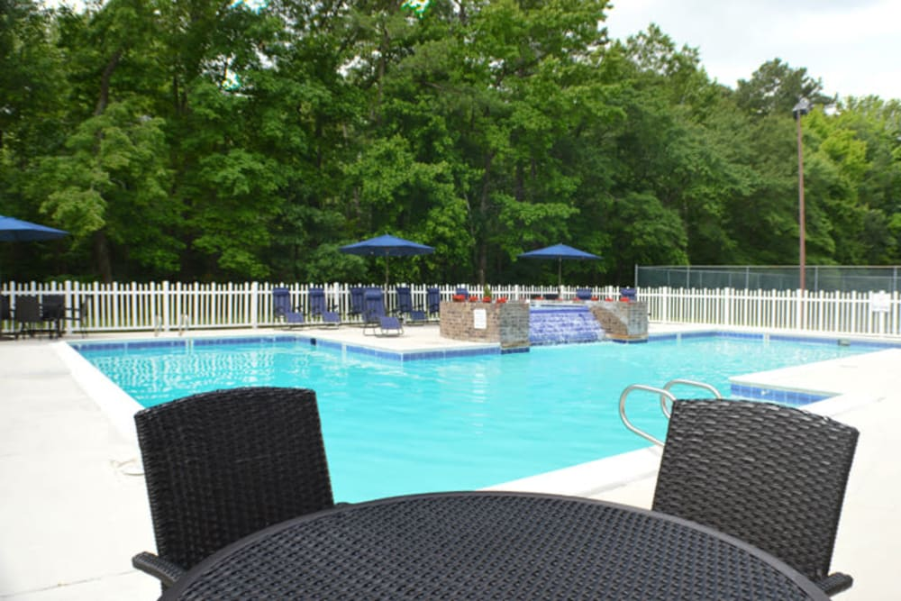 Pool-side patio seating at Laurel Pines Apartments in Richmond, Virginia