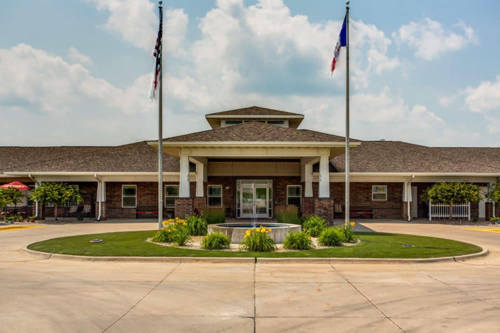 Exterior view of main entrance and fountain and courtyard at Prairie Hills in Tipton, Iowa.
