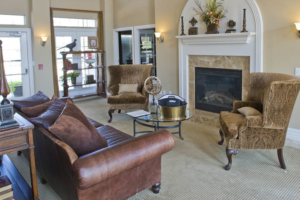 A lounge area with fireplace at Villas at Stonebridge in Edmond, Oklahoma