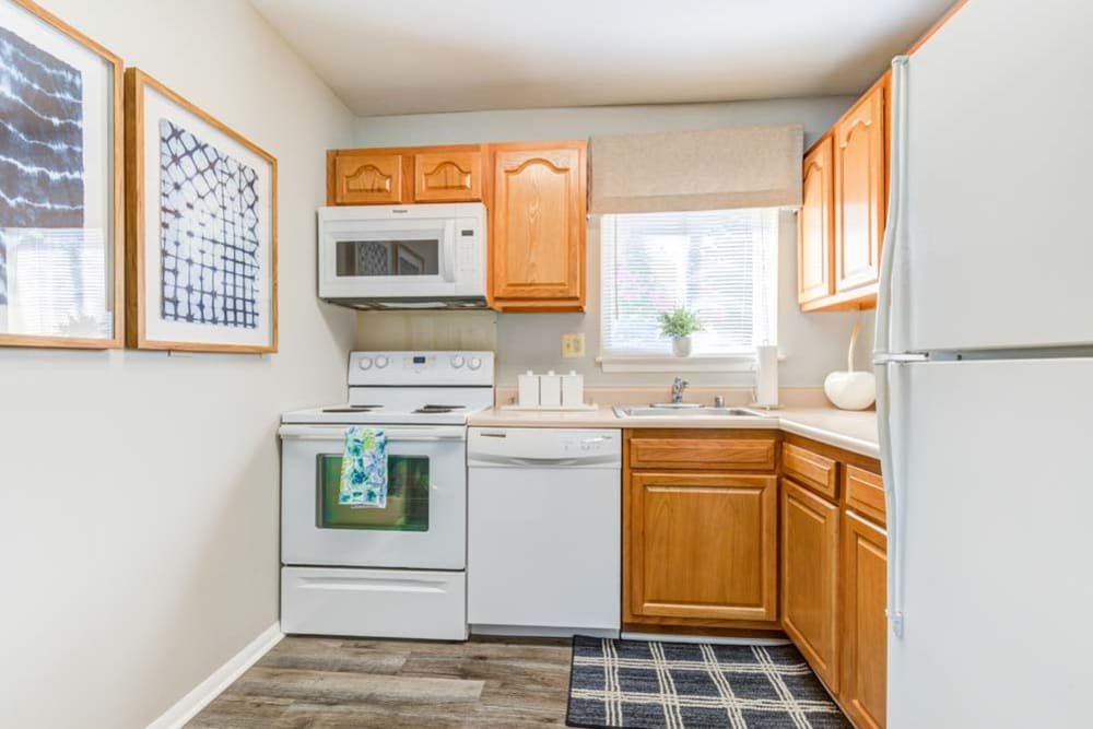 Kitchen with white appliances at Heritage Woods in Bel Air, Maryland