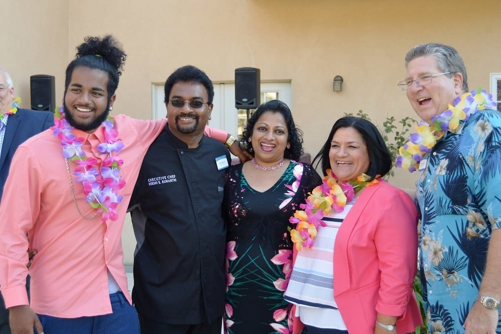 Residents and Staff Enjoying Hawaiian Party at Merrill Gardens at Santa Maria in Santa Maria, California.