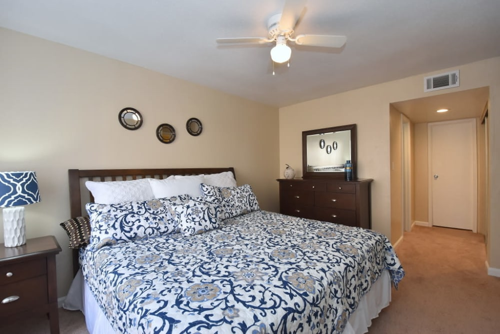 Bedroom with fan at Green Meadows Apartments