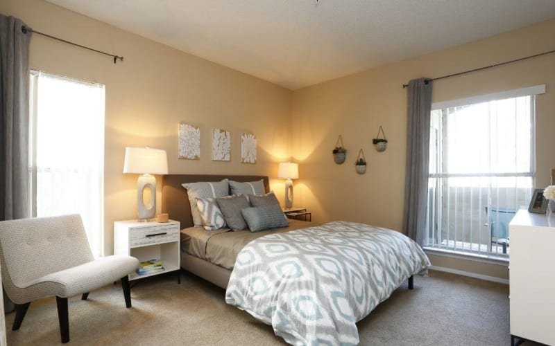 Spacious master bedroom with plush carpeting at Altitude Westminster in Westminster, Colorado