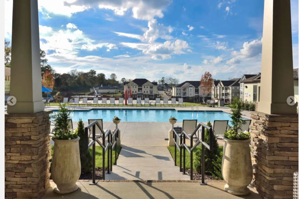 Gorgeous day approaching the swimming pool area at The Retreat at Arden Village Apartments in Columbia, Tennessee