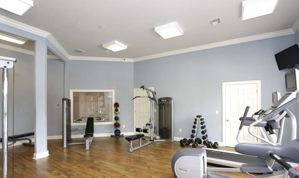 Fitness center at Springs at Live Oak Apartments