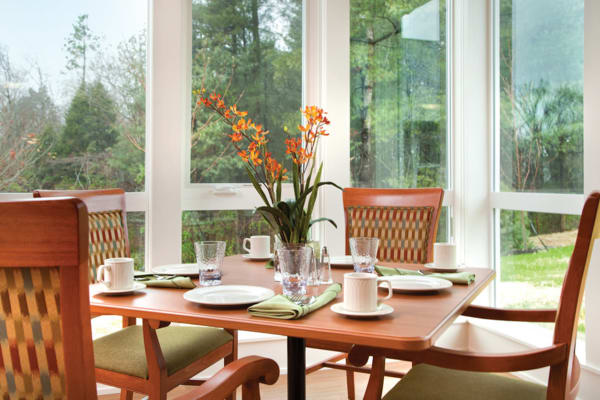 Dining room with a view at Avenir Memory Care at Fayetteville in Fayetteville, Arkansas.