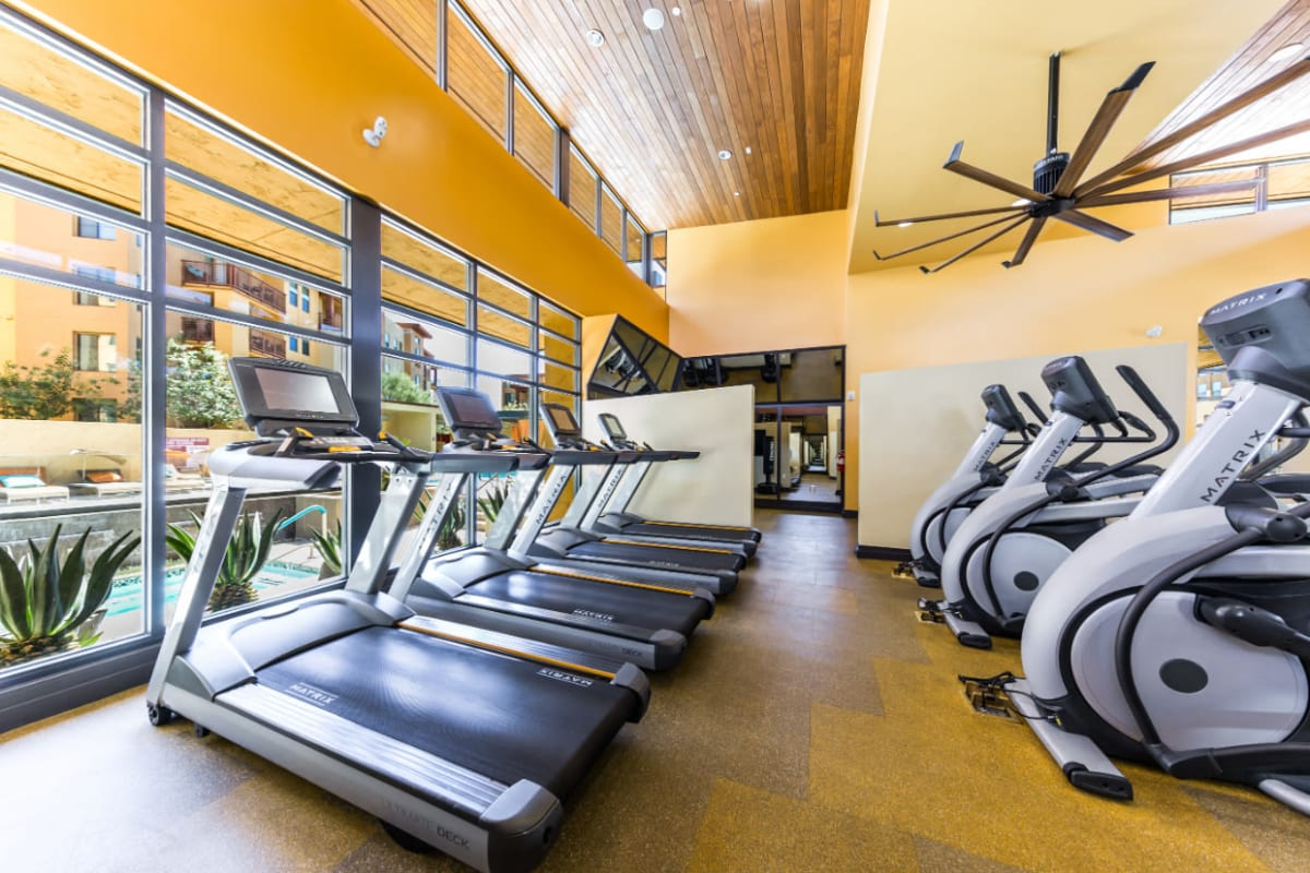 Treadmills and elliptical machines with view of pool deck at Marquis at Desert Ridge in Phoenix, Arizona