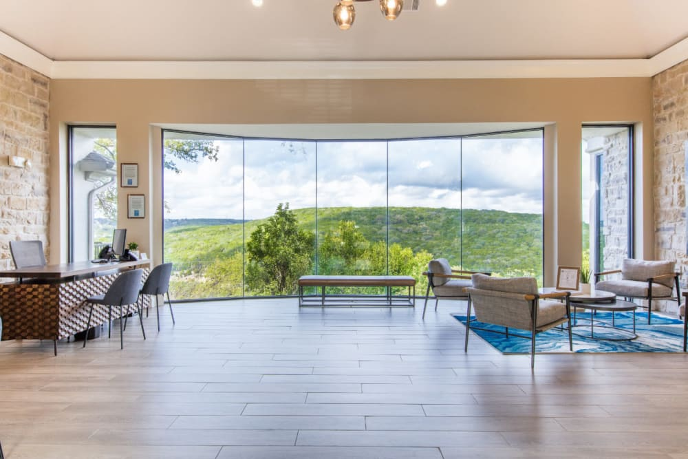 Inviting lobby with scenic view at Marquis at Treetops in Austin, Texas