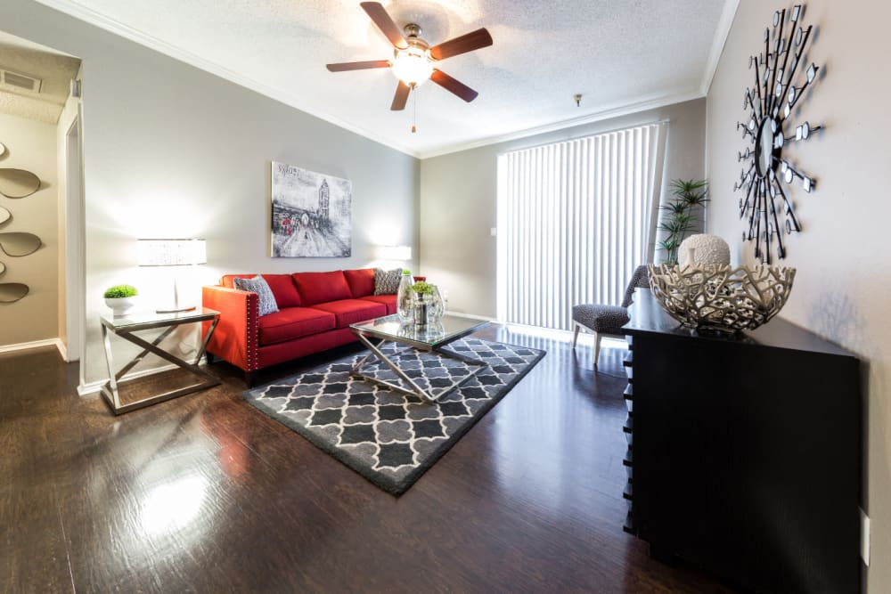 Bright living area with wood style flooring at Marquis at Legacy in Plano, Texas