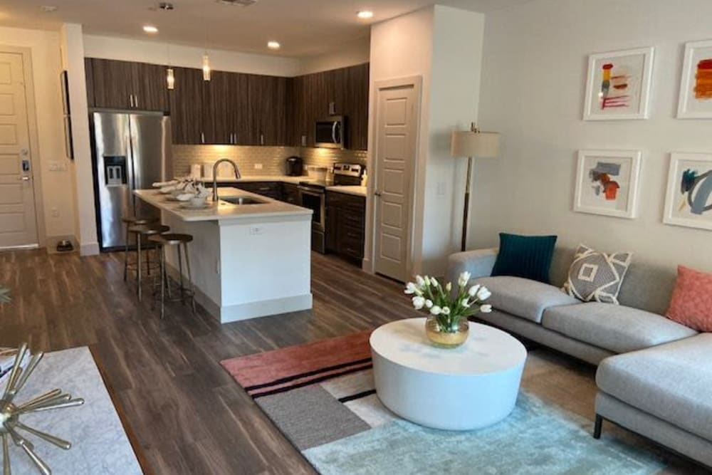 View Of Apartment Kitchen From Living Room At The District at Chandler In Chandler, Arizona