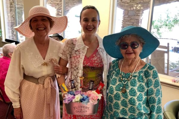 Residents with a candy bouquet at Salishan Gracious Retirement Living in Spring Hill, Florida