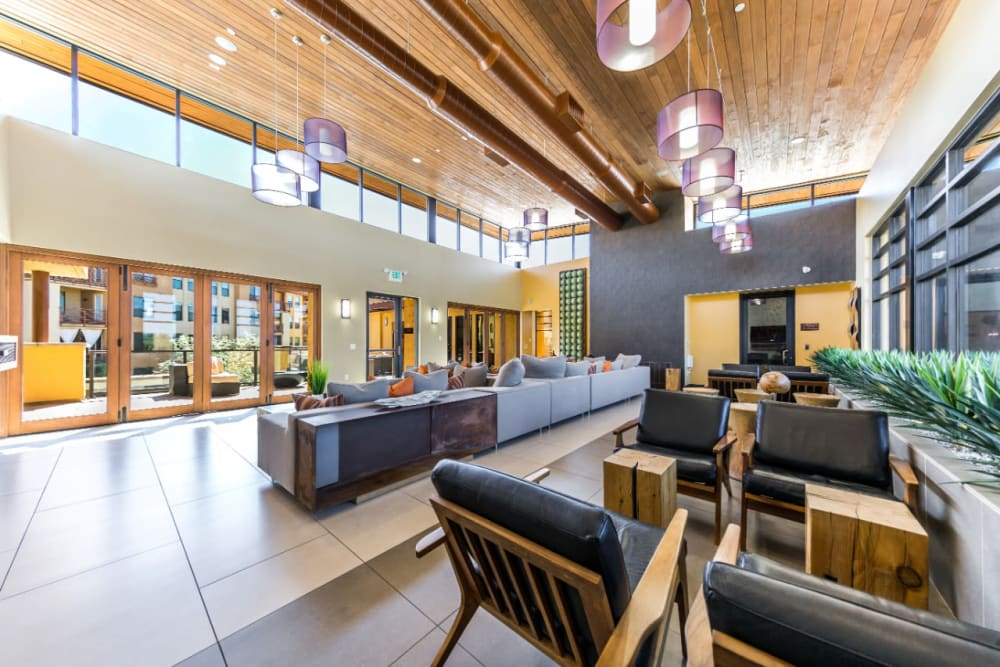 Community clubhouse with several sitting couches with many windows at Marquis at Desert Ridge in Phoenix, Arizona