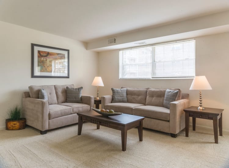 Modern decor in spacious living area of model home at Westgate Apartments & Townhomes in Manassas, Virginia