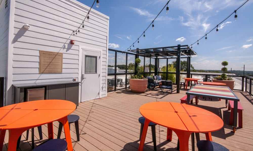 Roof top patio with tables at The Atlantic Aerotropolis in Hapeville, Georgia