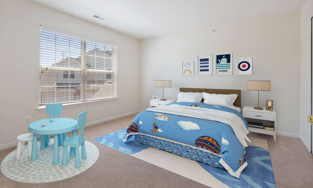 Well decorated model bedroom at CiderMill Village