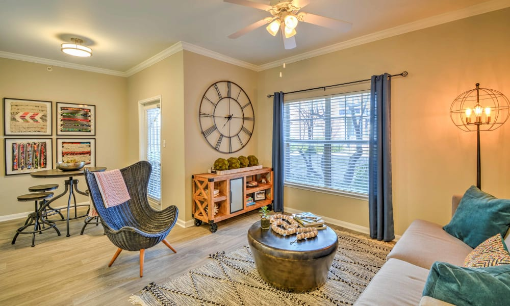 A spacious sunlit living room at The Atlantic Station in Fort Worth, Texas
