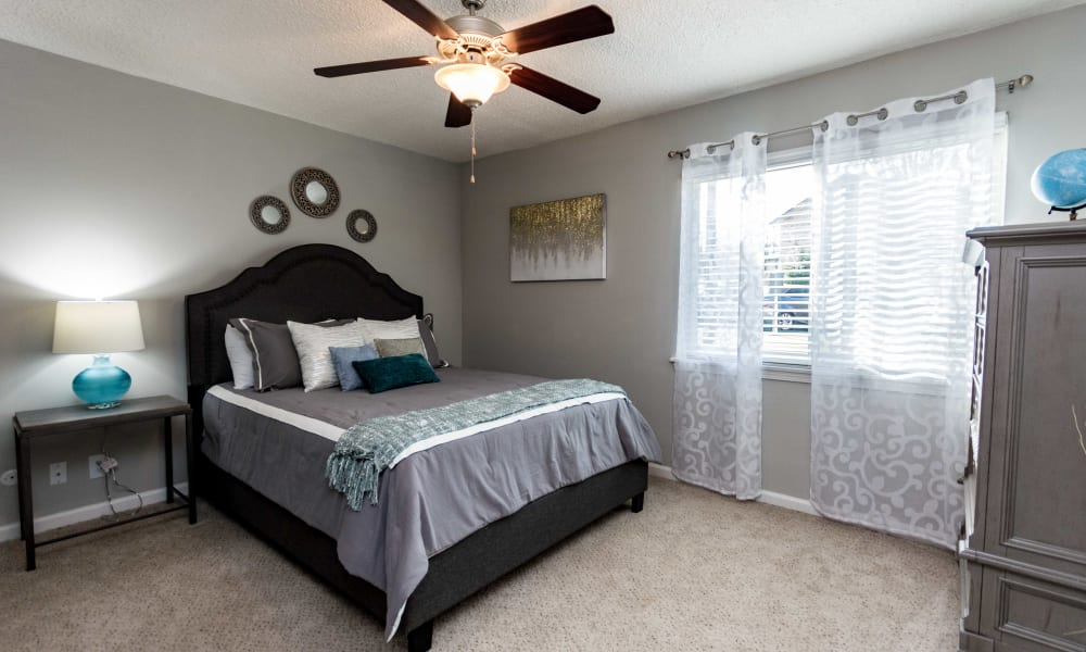 Bedroom with grey bedding at Lexington Park Apartments in Smyrna, Georgia