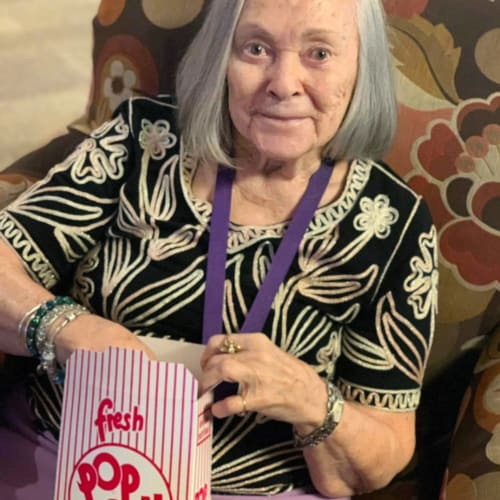 Resident eating popcorn at FountainBrook in Midwest City, Oklahoma