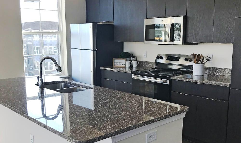 Stainless-steel appliances & granite countertops at Nexus Luxury Apartments in Virginia Beach, Virginia