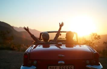 People in car enjoying the sunset