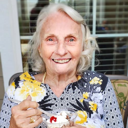A resident enjoying an ice cream sundae at The Oxford Grand Assisted Living & Memory Care in Kansas City, Missouri