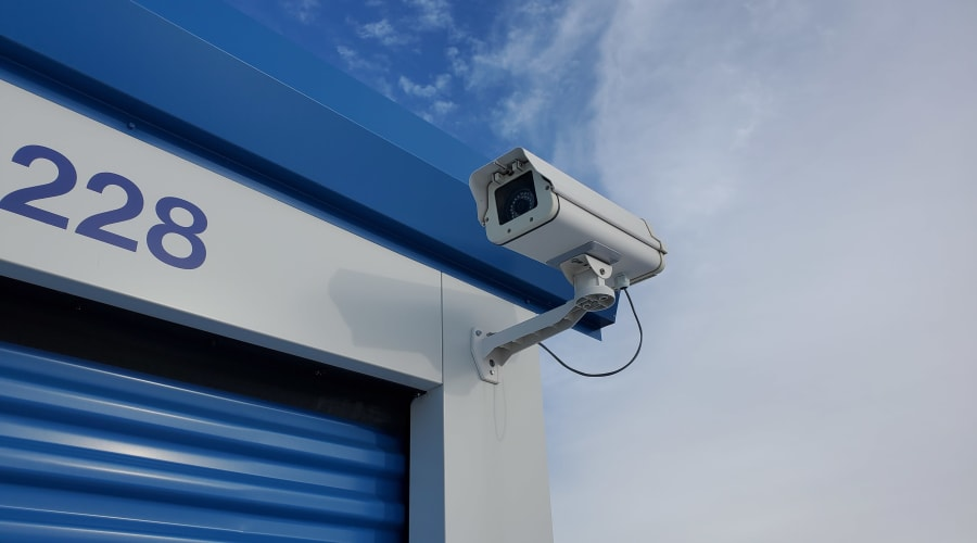 A security camera mounted on the corner of a building at KO Storage of Waseca 15th Ave in Waseca, Minnesota