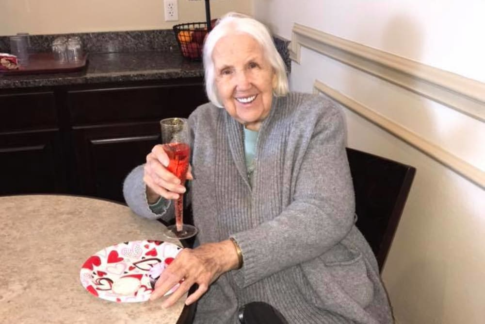 A resident celebrating Valentine's day at Oak Pointe of Warrenton in Warrenton, Missouri