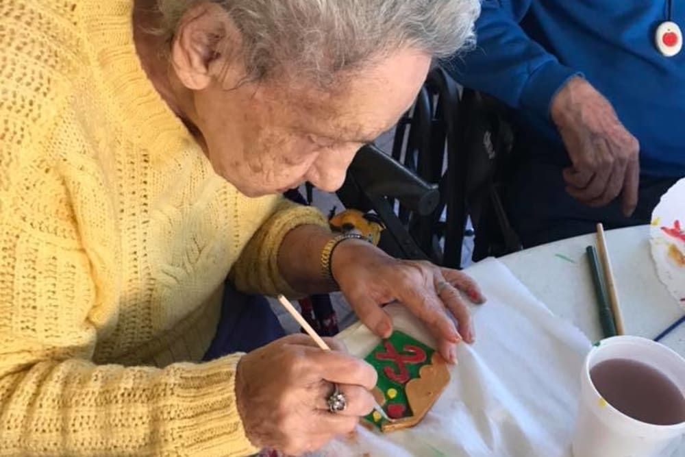 A resident decorating cookies at Spring Oaks in Brooksville, Florida